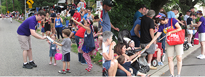 Handing out children's books in Glenside's 4th of July Parade 2016